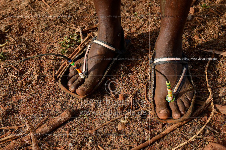 TANZANIA, Korogwe, Massai in Kwalukonge village, rubber sandals with antenna made from car tyre / TANSANIA, Korogwe, Massai im Dorf Kwalukonge, Sandalen aus Autoreifen