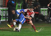 KV Kortrijk - Racing Genk : duel tussen Derrick Tshimanga (links) en Brecht Dejaegere.foto VDB / BART VANDENBROUCKE