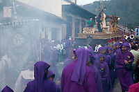 Antigua, Guatemala.  Incense Clouds Fill the Air as a Float (Anda) in a Religious Procession Moves down a Narrow Street during Holy Week, La Semana Santa.