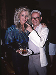 Buck Henry and Sally Kirkland attend a movie premiere on September 6, 1988 in Los Angeles, California.