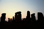 Stonehenge Wiltshire June 21st dawn sunrise. at the summer solstice. 1970s. A small group of people gather to watch the Druid ceremony. 1970s.