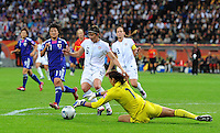 Goalkeeper Hope Solo, Christie Rampone (r) and Amy Le Peilbet of team USA and Shinobu Ohno of team Japan during the FIFA Women's World Cup Final USA against Japan at the FIFA Stadium in Frankfurt, Germany on July 17th, 2011.
