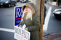 Ron Paul supporters stand on a street corner near a Jon Huntsman campaign event at Crosby's Bakery in Nashua, New Hampshire, on Jan. 9, 2012.  Paul and Hunstman are seeking the 2012 Republican presidential nomination.