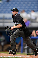 Home plate umpire Rich Grassa gets into position to make a call during a NYPL game between the Batavia Muckdogs and Jamestown Jammers on June 27, 2013 at Dwyer Stadium in Batavia, New York.  The game was postponed during the fourth inning due to rain.  (Mike Janes/Four Seam Images)