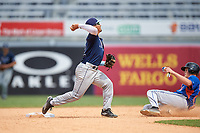 Carlos Cortes (2) of Oviedo High School in Oviedo, Florida playing for the Tampa Bay Rays scout team throws to first base as Walker Robbins (21) slides in during the East Coast Pro Showcase on July 30, 2015 at George M. Steinbrenner Field in Tampa, Florida.  (Mike Janes/Four Seam Images)