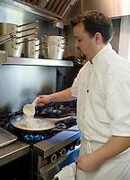 Chef Matt Regan Victorian Inn Lafiette New Orleans preparing a roux to make freah gumbo