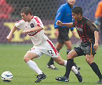 Logan Pause of the Fire being chased by Amado Guevara of the MetroStars. The Chicago Fire defeated the NY/NJ MetroStars 3-2 on 6/14/03 at Giant's Stadium, NJ..
