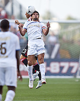 Olimpia defender Jose Arevalo (22) beats AC Milan midfielder Massimo Ambrosini (23) to a head ball.  AC Milan defeated Olimpia 3-1 at Gillette Stadium on August 4, 2012