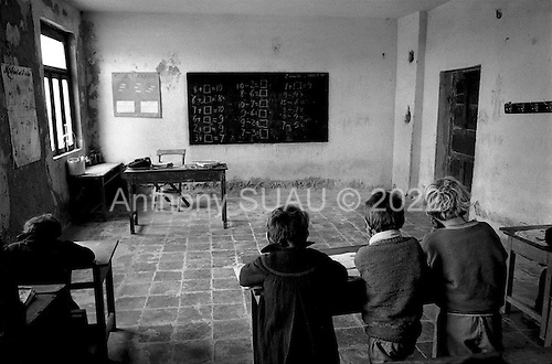 """Sector Adriatic, Albania<br /> February 1997<br /> <br /> School in an old barn which is part of a former political internment camp in an area know as """"The Dead Lands"""". Even the instructors wear coats to stay warm. Many of the students have no books."""