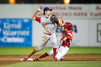 Williamsport Crosscutters second baseman Tyler Greene #13 attempts to turn a double play as Steve Ramos slides in during a NY-Penn League game against the Batavia Muckdogs at Dwyer Stadium on August 11, 2012 in Batavia, New York.  Williamsport defeated Batavia 5-4.  (Mike Janes/Four Seam Images)