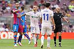 FC Barcelona's Sergio Busquets (l) and Getafe CF's Sandro Ramirez (c) and Carles Alena have words in presence of Spanish referee Pablo Gonzalez Fuertes (r) during La Liga match. August 29, 2021. (ALTERPHOTOS/Acero)