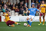 Motherwell v St Johnstone...30.08.14  SPFL<br /> Paul Lawson slides in on Chris Millar<br /> Picture by Graeme Hart.<br /> Copyright Perthshire Picture Agency<br /> Tel: 01738 623350  Mobile: 07990 594431