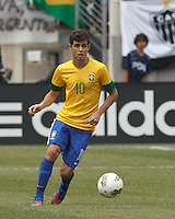 Brazil midfielder Oscar (10) brings the ball forward. In an international friendly (Clash of Titans), Argentina defeated Brazil, 4-3, at MetLife Stadium on June 9, 2012.
