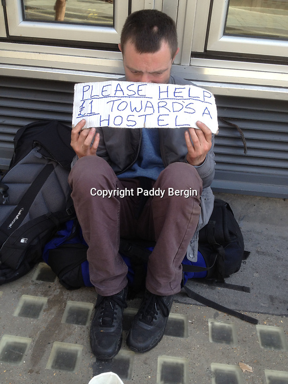 Homeless man collecting money to pay for a night in a hostel, Covent Garden, London.<br /> <br /> Stock Photo by Paddy Bergin