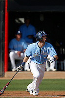 Louie Lechich #21 of the University of San Diego Toreros bats against the Cal State Northridge Matadors at Matador Field on March 26, 2013 in Northridge, California. (Larry Goren/Four Seam Images)