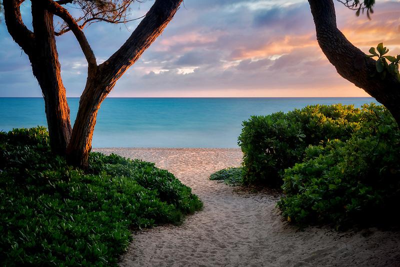 Pathway to beach with sunrise. Kalama Beach Park. Oahu, Hawaii