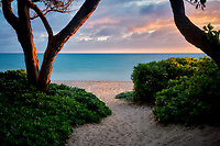 Pathway to beach with sunrise. Kalama Beach Park. Oahu, Hawaii