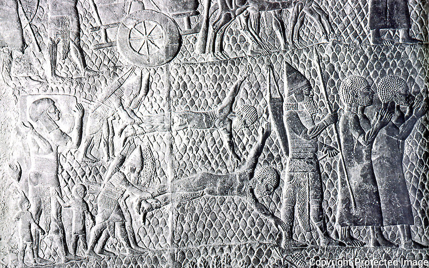 Assyria:  The Siege of Lachish--Hebrew prisoners beign flayed alive. Ninevah:  Palace of Sennacherib.  Photo '85.