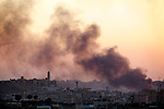 Smoke rises near the historical Old City of Aleppo after a fighter jet dropped two bombs apparently targeting fighting positions in this heavily populated suburb of Aleppo...© Javier Manzano