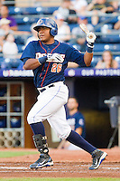 Daniel Mayora #26 of the Durham Bulls follows through on his swing against the Charlotte Knights at Durham Bulls Athletic Park on August 28, 2011 in Durham, North Carolina.   (Brian Westerholt / Four Seam Images)