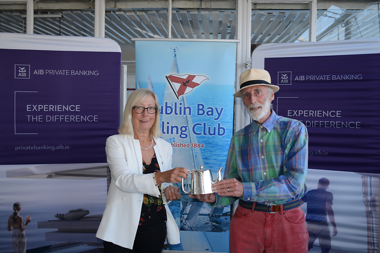 DBSC Commodore Ann Kirwan presents Vincent Delany of the Wags (and other classes) with his prize