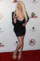 """LOS ANGELES, CA - NOVEMBER 16: Courtney Stodden wearing a Maggie Barry Haute Couture evening gown from the M8 Collection attends The Los Angeles Police Protective League Eagle & Badge Foundation's 12th Anniversary """"In The Line Of Duty"""" Awards held at the JW Marriott Los Angeles at L.A. Live on November 16, 2013 in Los Angeles, California. (Photo by Xavier Collin/Celebrity Monitor)"""