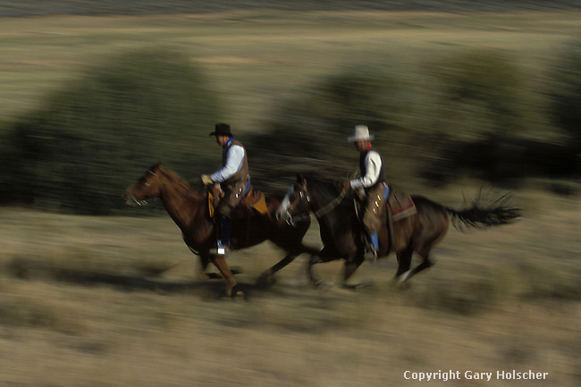 Cowboys on running horses, blurred. Ponderosa Ranch. Senaca OR.