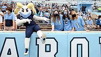 CHAPEL HILL, NC - OCTOBER 10: North Carolina's mascot Rameses socially distances himself from some fans during a game between Virginia Tech and North Carolina at Kenan Memorial Stadium on October 10, 2020 in Chapel Hill, North Carolina.
