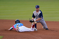 Shortstop Nick Sogard (11) of the Greenville Drive is tagged out at second base by Luke Ritter (19) of the Brooklyn Cyclones on Saturday, May 15, 2021, at Fluor Field at the West End in Greenville, South Carolina. (Tom Priddy/Four Seam Images)