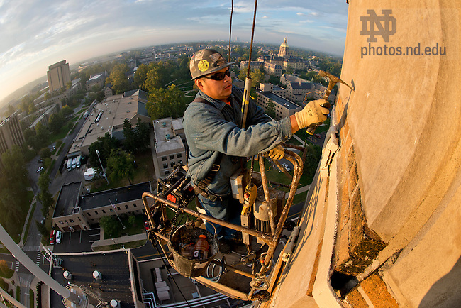Sept. 25, 2013; Wesley Shirley does some routine maintenance on the chimney of Notre Dame's power plant.  Photo by Barbara Johnston/University of Notre Dame