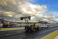May 20, 2011; Topeka, KS, USA: NHRA top fuel dragster driver Larry Dixon (near lane) along side Tony Schumacher during qualifying for the Summer Nationals at Heartland Park Topeka. Mandatory Credit: Mark J. Rebilas-