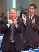 June 6 , 2002, Montreal, Quebec, Canada<br /> <br />  Bernard Landry, Quebec Premier (L) and<br /> Andre Boisclair, Quebec Minister Municipal Affairs,<br /> Quebec Minister Environment applaud (R)<br />  after Gerald Tremblay, Montreal Mayor <br /> speech at  the closing  of the Montreal Summit<br />  (Le Sommet de Montr»al), June 6, 2002<br /> <br /> <br />  <br /> Mandatory Credit: Photo by Pierre Roussel- Images Distribution. (©) Copyright 2002 by Pierre Roussel <br /> ON SPEC<br /> NOTE l Nikon D-1 jpeg opened with Qimage icc profile, saved in Adobe 1998 RGB.