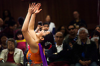 A dancer from the China Dance School of San Francisco performs during a Lunar New Year Celebration at a neighborhood library.