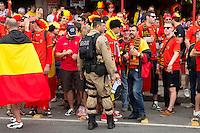 A heavy military and police presence around the Maracana stadium keep a watch on the fans