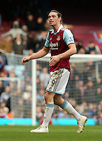 Pictured: Andy Carroll of West Ham is getting off the pitch protesting having been shown a red card by match referee Howard Webb for his header challenge against Chico Flores of Swansea. 01 February 2014<br />