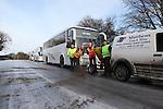 Bus Company Grits Roads
