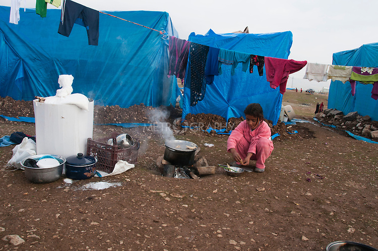 ARBAT, IRAQ: A Syrian girl makes food in the Arbat refugee camp...45 families who have fled the violence in Syria are currently living in the Arbat refugee camp 19km outside the Iraqi city of Sulaimaniyah...Photo by Zmnako Ismael/Metrography