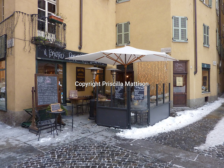 Turin, Italy - February 5, 2012:  A cafe offers outdoor seating in winter.