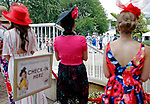 ARLINGTON HEIGHTS, IL - AUGUST 12: Women wait in line for the Best Dressed Competition as they watch the men compete on Arlington Million Day at Arlington Park on August 12, 2017 in Arlington Heights, Illinois. (Photo by Jon Durr/Eclipse Sportswire/Getty Images)