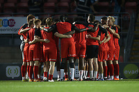 Orient players huddle during Leyton Orient vs Plymouth Argyle, Caraboa Cup Football at The Breyer Group Stadium on 15th September 2020
