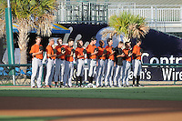 Bullpen pitchers for the Frederick Keys listen to the National Anthem before a game on August 4, 2012, at TicketReturn.Com Field in Myrtle Beach, South Carolina. (Tom Priddy/Four Seam Images)
