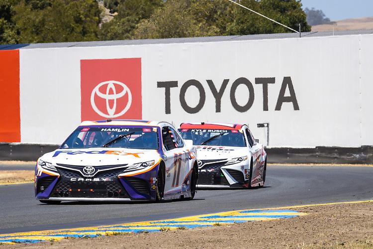 #11: Denny Hamlin, Joe Gibbs Racing, Toyota Camry FedEx Express, #18: Kyle Busch, Joe Gibbs Racing, Toyota Camry Sport Clips
