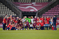KASHIMA, JAPAN - AUGUST 5: The USWNT pose for a photo after a game between Australia and USWNT at Kashima Soccer Stadium on August 5, 2021 in Kashima, Japan.