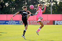 Rebecca Moros (38) of the Western New York Flash and Casey Nogueira (27) of Sky Blue FC. The Western New York Flash defeated Sky Blue FC 2-0 during a Women's Professional Soccer (WPS) match at Yurcak Field in Piscataway, NJ, on July 17, 2011.
