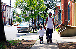 Seeing parents acting responsibly and raising their children right just makes you want to throw all the negative images society showcases into the trash can. Rahmeel Moore and his son Na'Zira Moore spend time together and walk down Market Street in Harrisburg, PA. JUSTIN A. SHAW/The Patriot-News