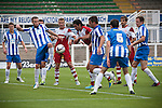 Hartlepool United 0 Middlesbrough 0, 20/07/2013. Victoria Ground, Pre-Season Friendly. Hartlepool United (in blue shirts) defending during the first-half at the Victoria Ground, Hartlepool, during a pre-season friendly between the home team and Middlesbrough. Hartlepool were relegated to League Two at the end of the 2012-13 season whilst their Teesside neighbours remained two divisions above them in the Championship. The game ended in a no-score draw watched by a crowd of 2307. Photo by Colin McPherson.