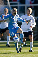 North Carolina Tar Heels defender Mandy Moraca (34) and Notre Dame Fighting Irish forward Taylor Knaack (4). The North Carolina Tar Heels defeated the Notre Dame Fighting Irish 2-1 during the finals of the NCAA Women's College Cup at Wakemed Soccer Park in Cary, NC, on December 7, 2008. Photo by Howard C. Smith/isiphotos.com