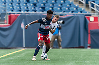 FOXBOROUGH, MA - JULY 25: USL League One (United Soccer League) match. Orlando Sinclair #99 of New England Revolution II attempts to control the ball as Luke Hauswirth #2 of Union Omaha  pressures during a game between Union Omaha and New England Revolution II at Gillette Stadium on July 25, 2020 in Foxborough, Massachusetts.