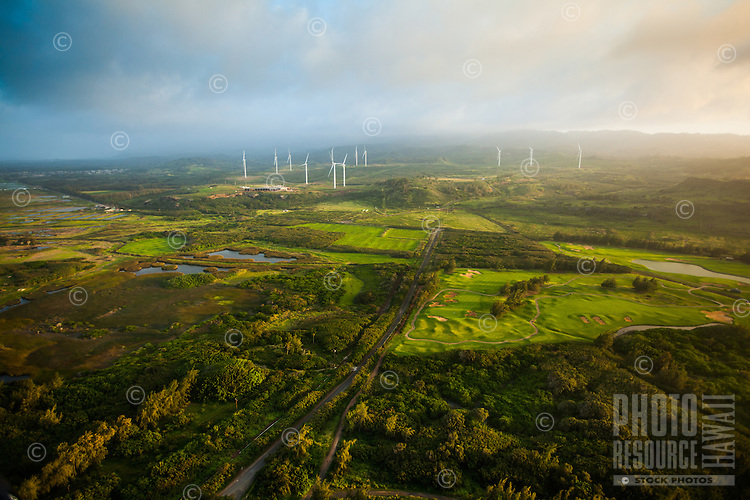 An aerial view above the road to a secret beach near Turtle Bay Resort, with windmills in the distance, O'ahu.
