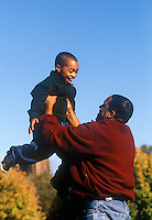 Dad throws his son in the air.